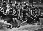 Black and White Photograph of Naga dancer wearing High Heel Shoes Getting Ready. Kohima, Nagaland, INDIA
