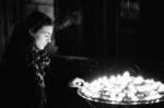 Girl lighting Candle Notre Dame Paris.